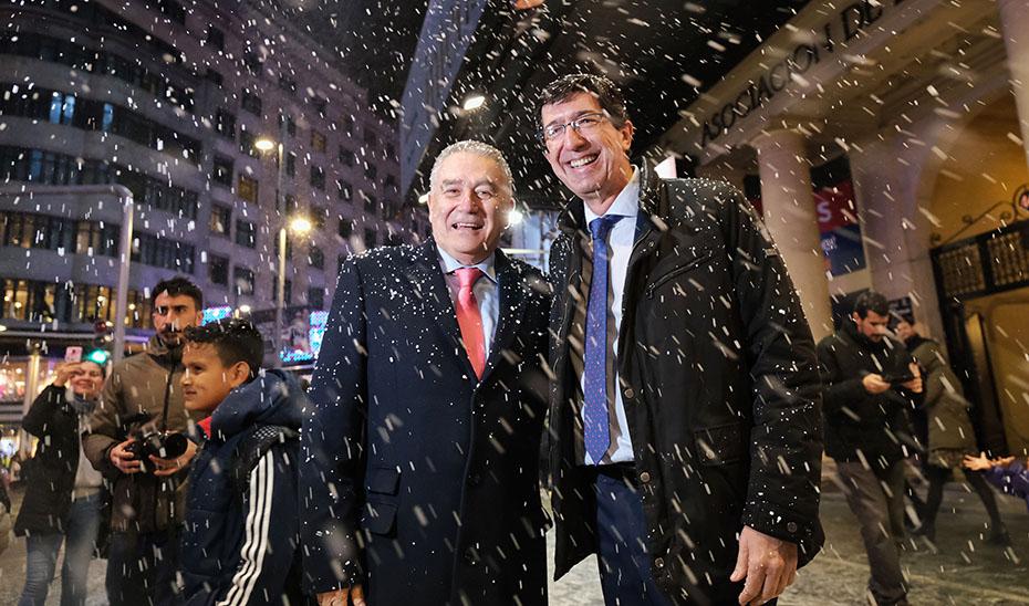 Juan Marín junto al secretario general de Turismo, Manuel Muñoz, promocionando en Madrid el destino turístico navideño andaluz.